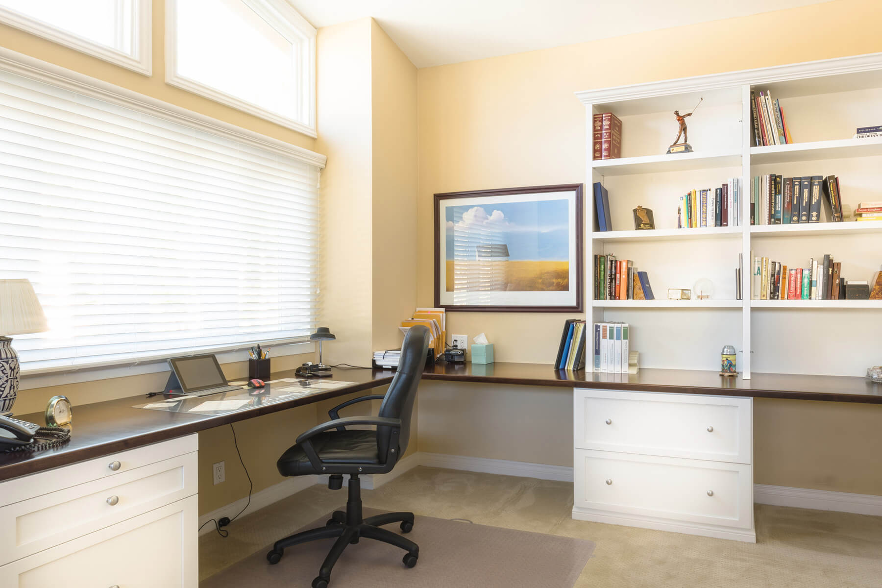 Home Office with Dual Built-In Desks and Floating Shelves