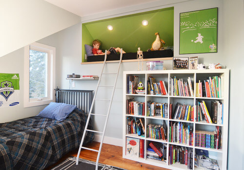 Here is a creative and exciting take on the reading nook. It is elevated, so it is out of the way. A ladder leads up to the tucked away reading space. The books are close by so there is no need to go far once finishing one story before you jump into another.