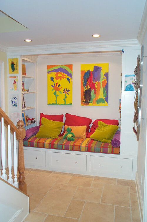 This nook is recessed into the wall and is bright, colorful, and welcoming. Children will be attracted to this spot, and with such bright colors you can have them get involved in the painting and design.