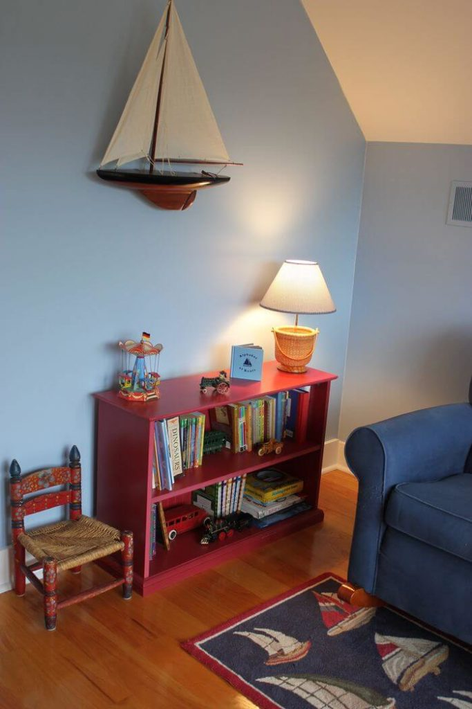 This cute reading area has multiple chairs, one for solo reading and one for when the children want to read with an adult. There are plenty of great books and even toys to play with during break time.