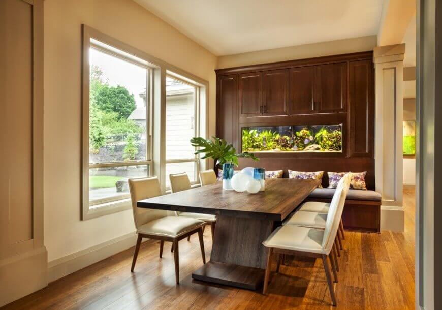 A Very Refreshing Dining Area With Wooden Floor And Hard Wood Table Its Sleek