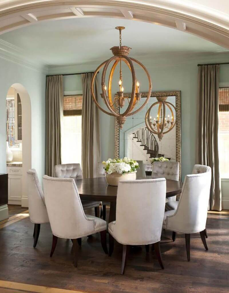 this round dining set for seven shows close family ties the old fashioned chandelier together - Best Dining Room Sets
