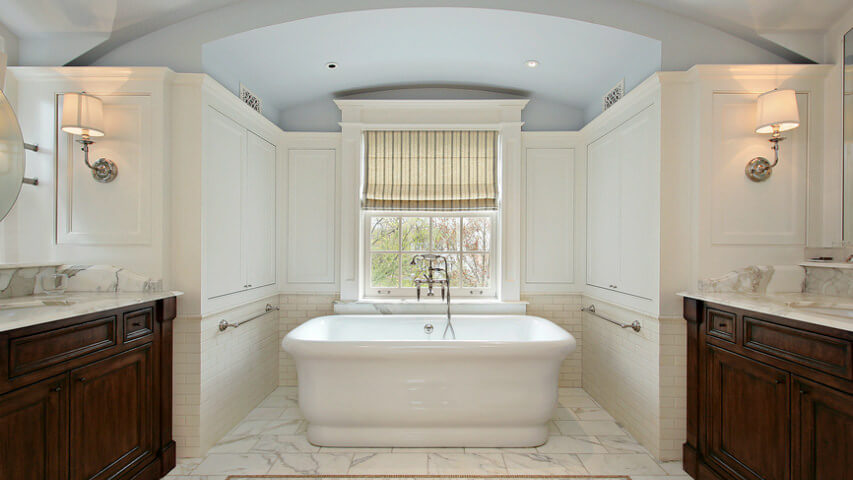 Elegant bathroom with dark brown (wood vanities), white, grey (ceiling) and very light tan.
