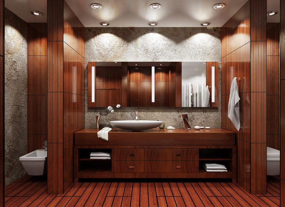 The mahogany colored wood palettes and vanities give a warm coordinating color combination to this bathroom.