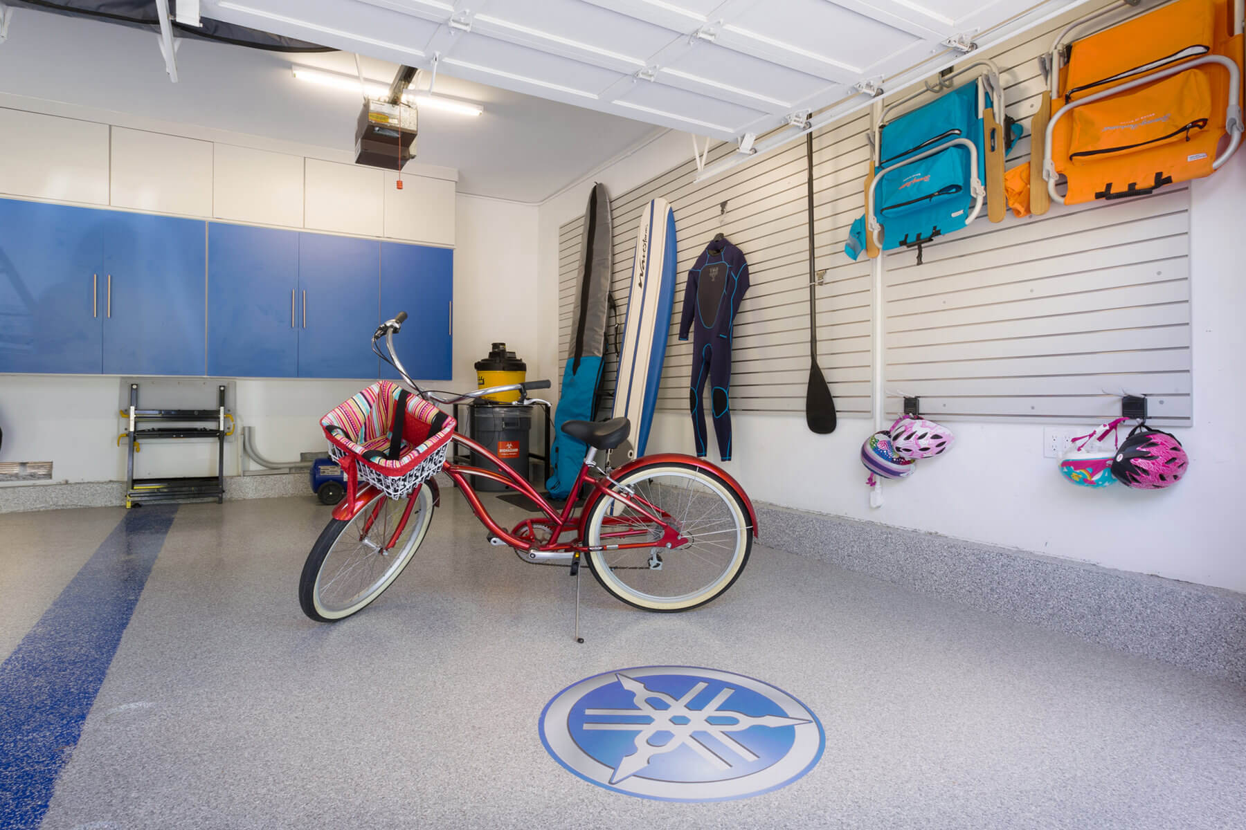 Sports enthusiasts can hang their gear and equipment in the custom slatwalls that can accommodate large items such as surfboards and wetsuits to medium-sized and smaller items such as sports bags and racing helmets.