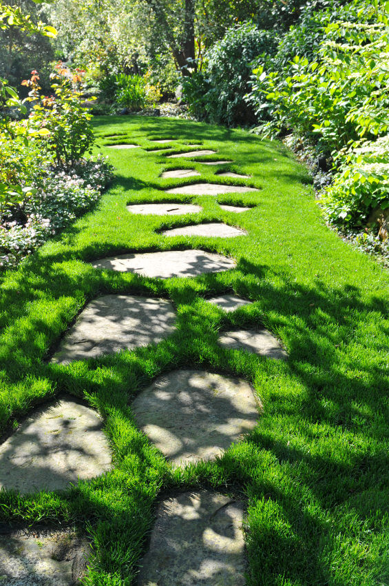 These flagstones seem to sink and drown with thick green grasses, which is obvious from each stone's gaps.