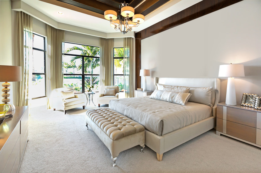 Neutral tones in combination with white carpet that runs through the entire room makes it very attractive. Sometimes just enough light creates all the magic.
