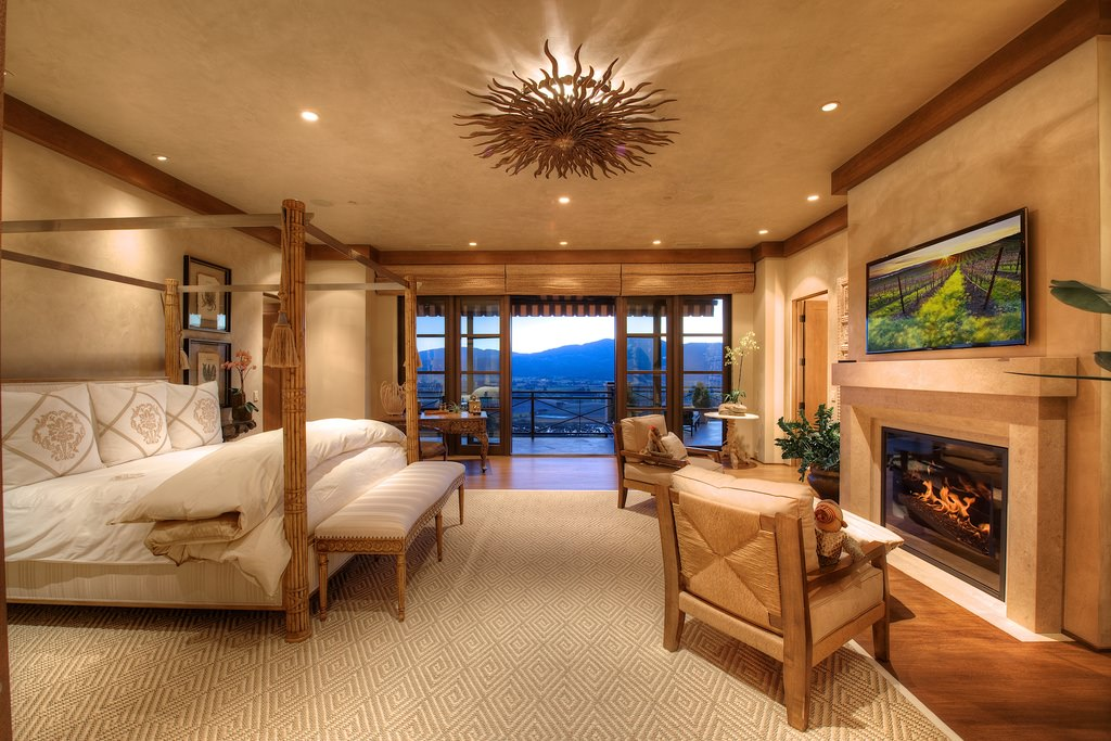 This is the bedroom worthy of a king. Of course what strikes the most difference is the view, while the sitting area enjoys the fireplace.