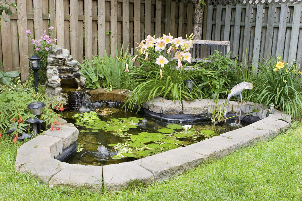 Tucked in the corner of the backyard, this pond has a cute metal heron statue, and a small waterfall for ambiance.