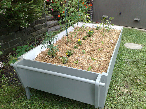 Of course, if you want something less wood-toned and stand out, you can always paint your raised bed a color that pops (or blends in). The choice is yours! We should note that the rod at the end of the bed is a great feature for hanging your garden tools on hooks while you are working on the garden.