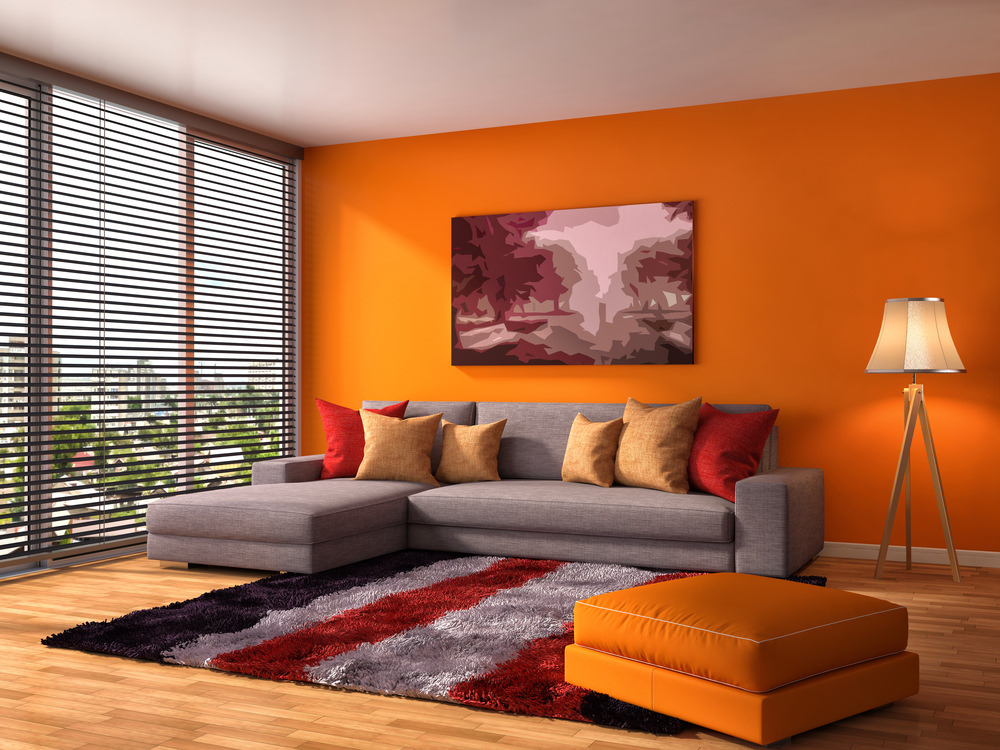 The Slick Orange Wall And Sofa Stool Stand Out Boldly In This Living Area. A Part 14