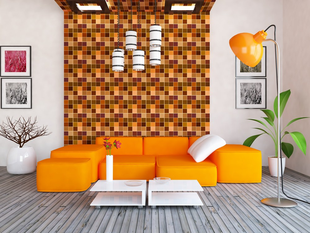 The orange patterns in different palettes on the accent wall playfully juxtapose light to dark shades of orange arranged in tiny squares. The geometrical sense of this orange design also works perfectly with the sofa set, while the orange floor lamp shows off its own shade.