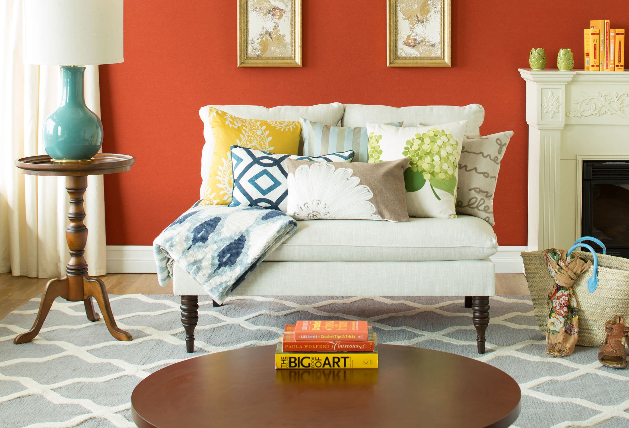 The simple orange background wall a few books stacked as a centerpiece and the