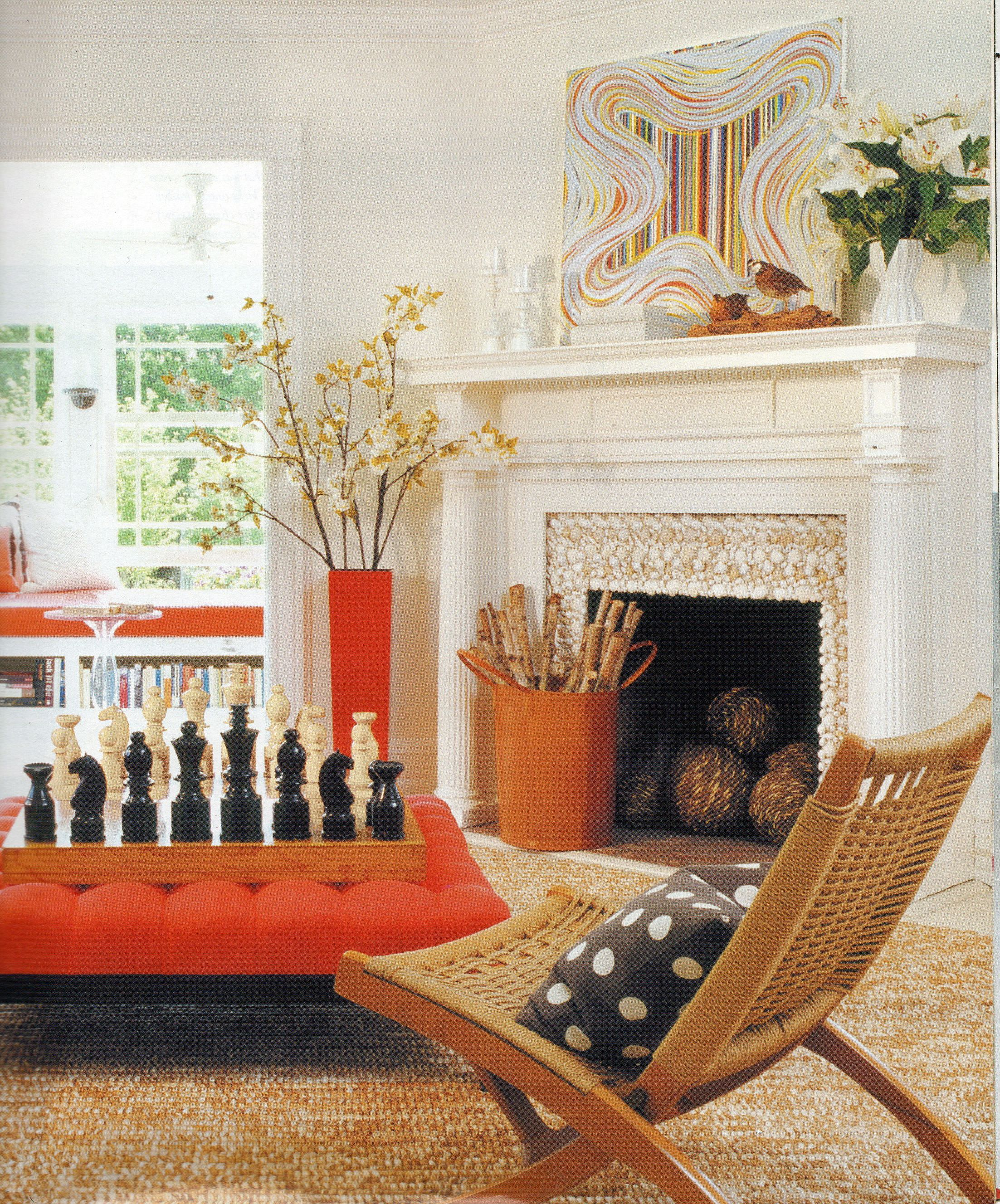 The delicate color selection of this living room departs from common living room color schemes by