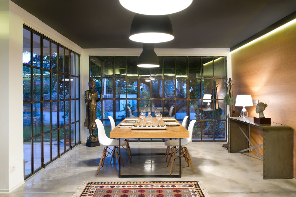 Asian figures, carpets and nature is reflected here. The glass walls allows the the beauty of outside nature to be seen from the inside.