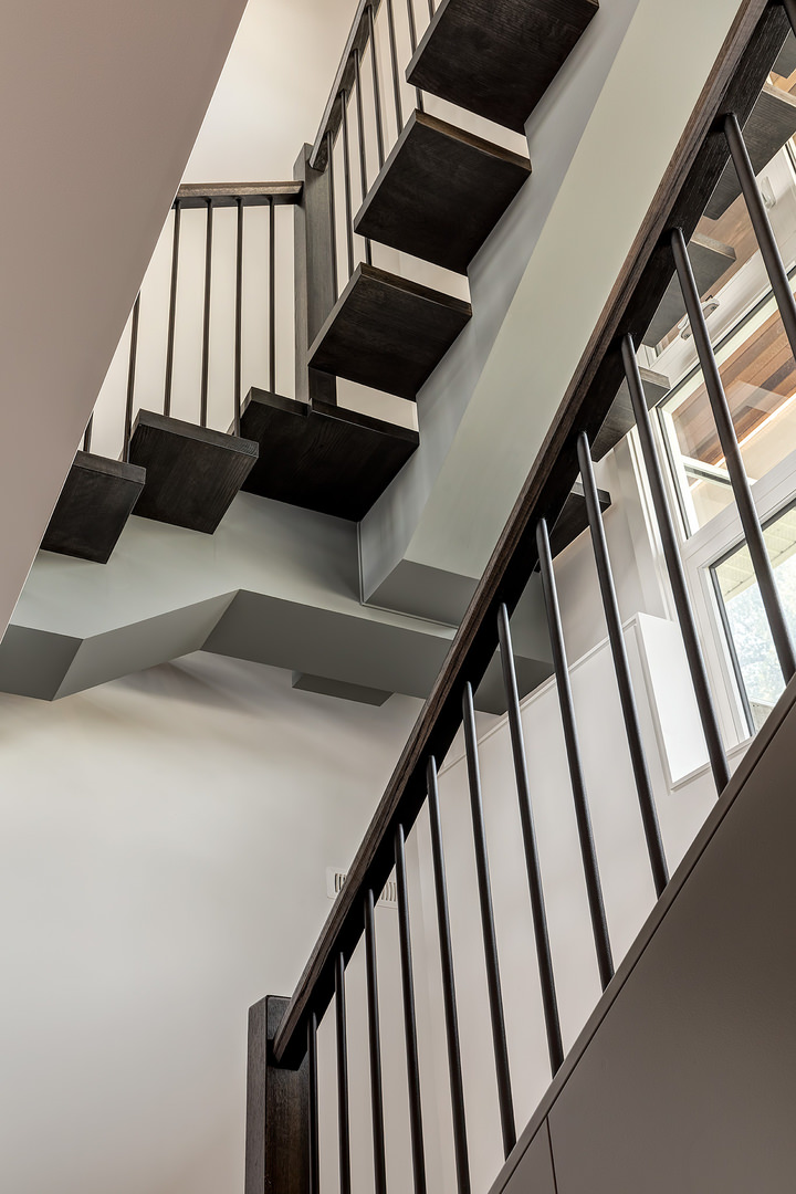 An amazing conventional staircase heading to the second level of the house.