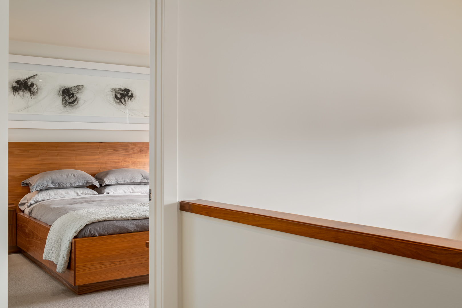 The walnut wood theme is even found in the bedrooms, with custom-made bed frames.