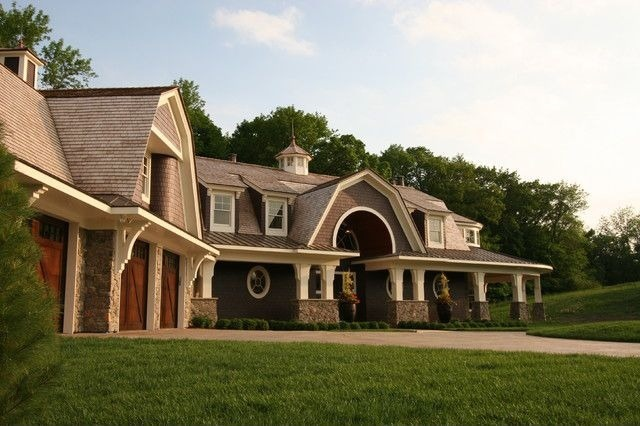 Large home with multiple gambrel sections including running the full length of the home as well as large gambrel shaped dormers.