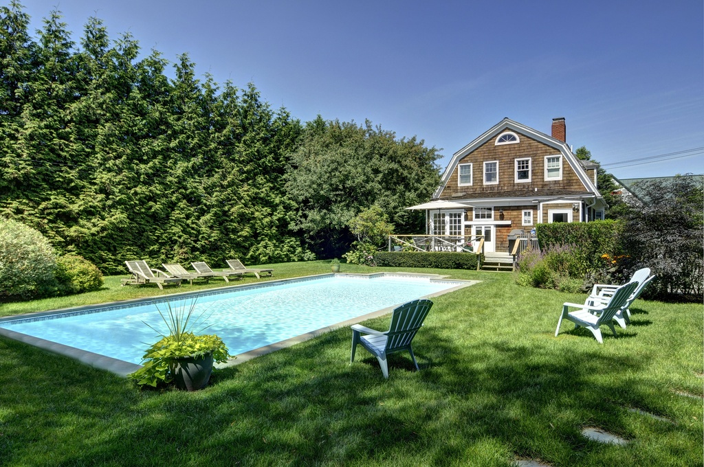Classic vacation shingle-style home with large gambrel roof.