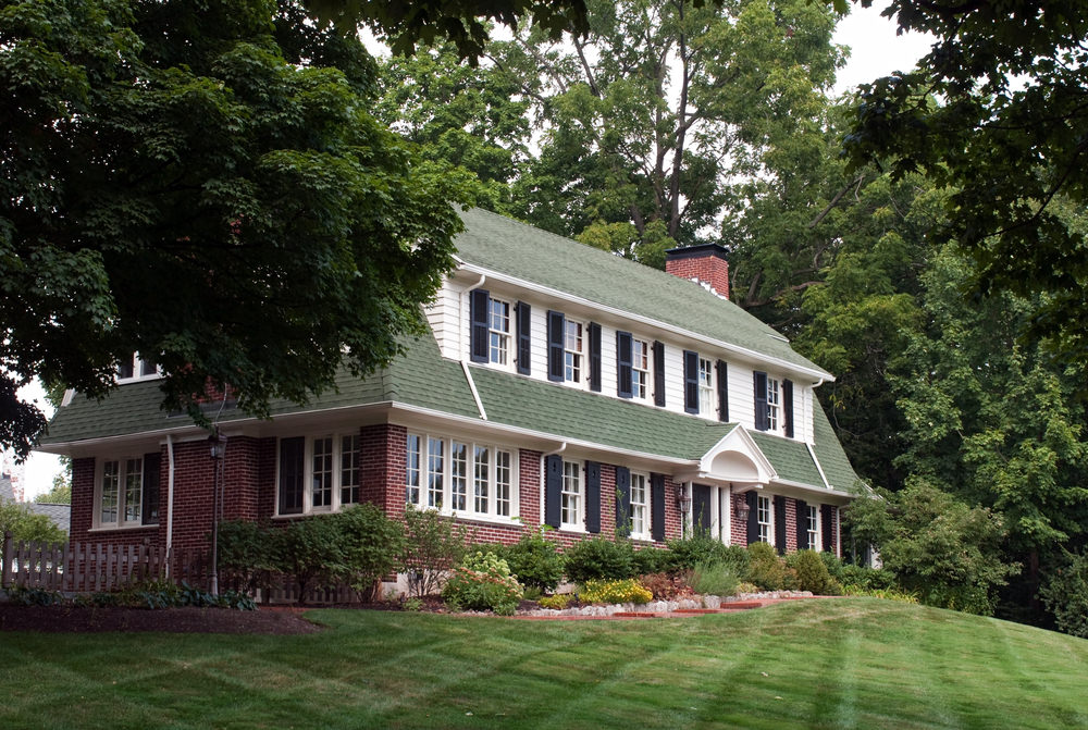 Classic gambrel roof running full length of the home.