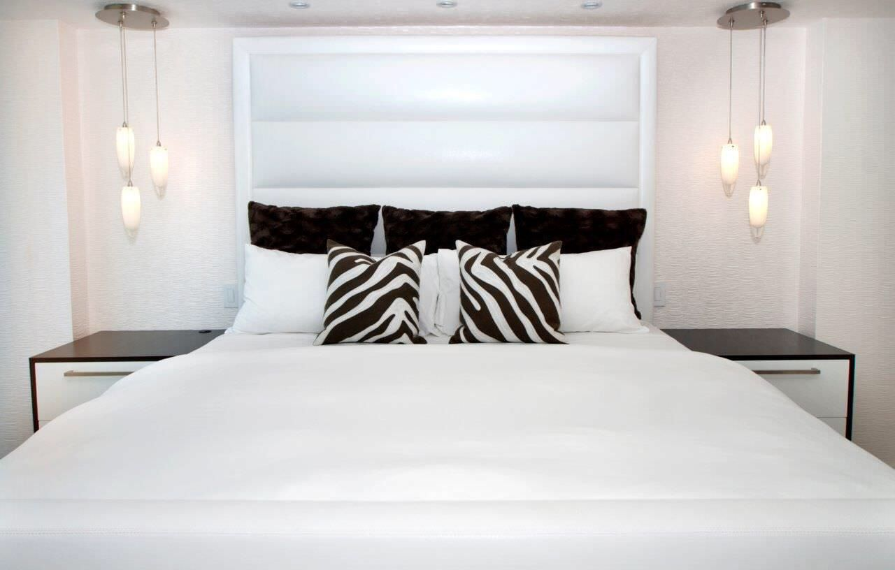 All white master bedrooms can give the illusion of looking larger than they are.