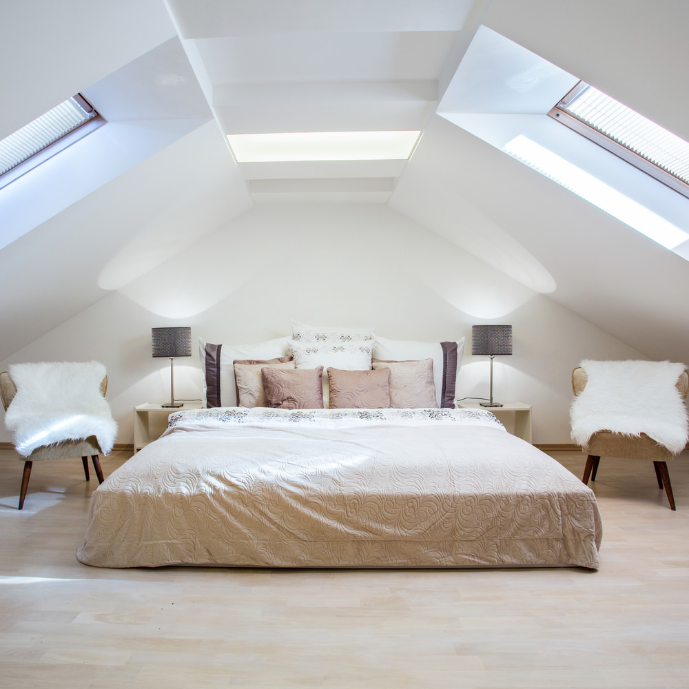 Here's another example where a low bed creates a larger looking space. This is also a great example of how white makes a space look larger.