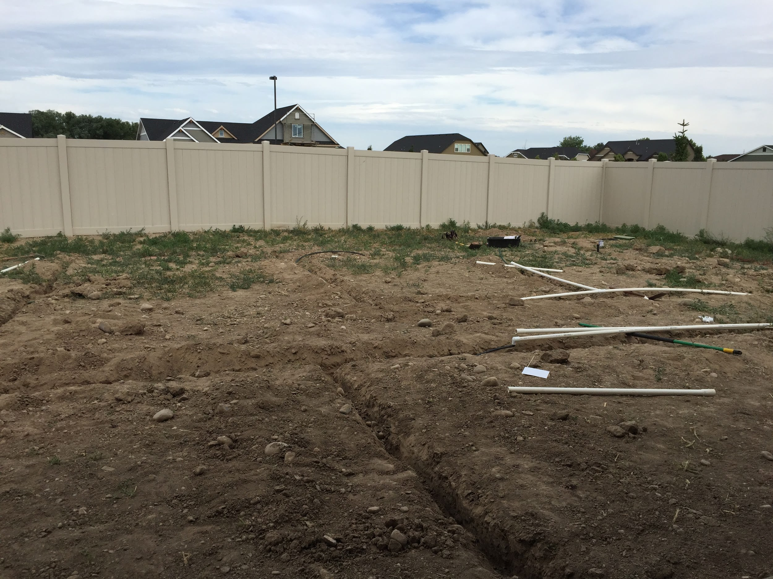 Preparing backyard to install DIY sprinkler system
