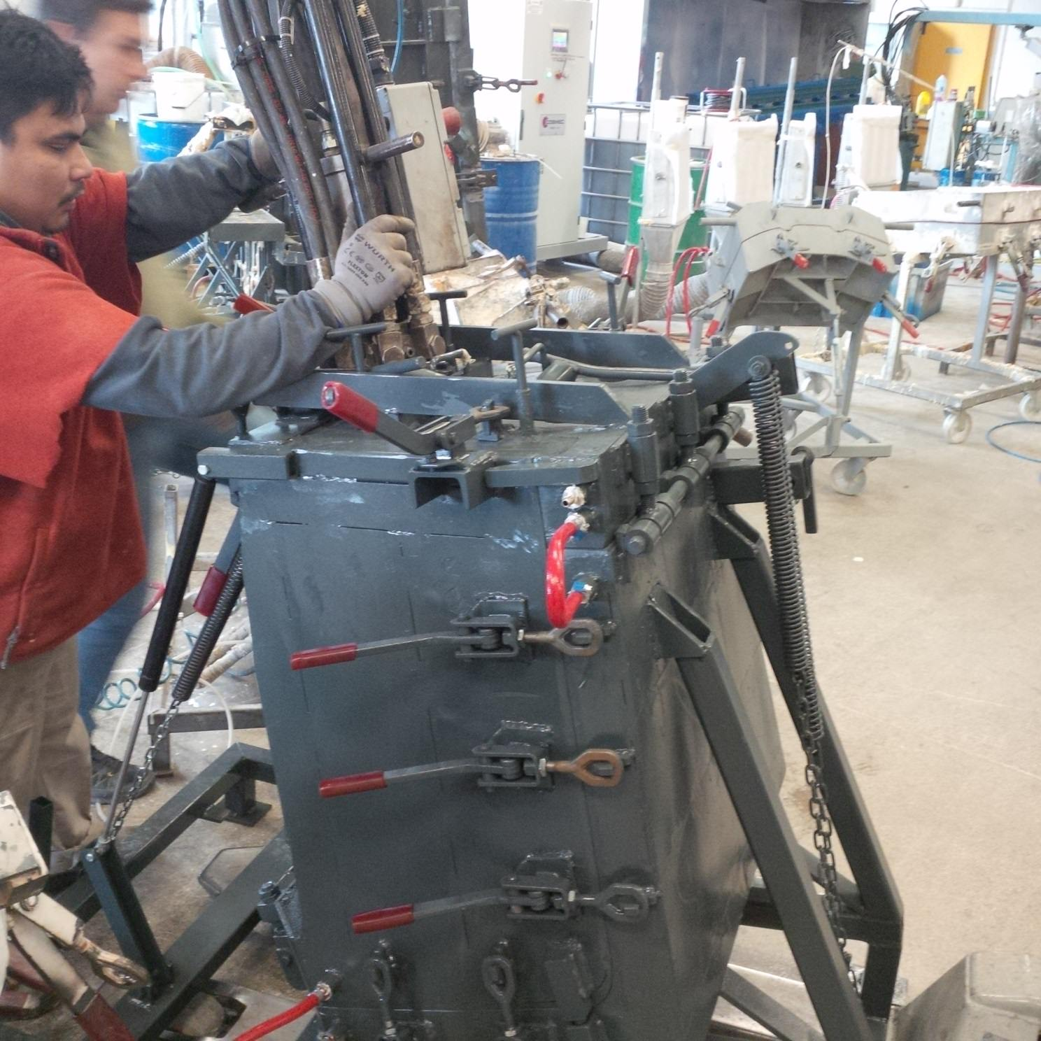 Picture of chair being created by factory worker