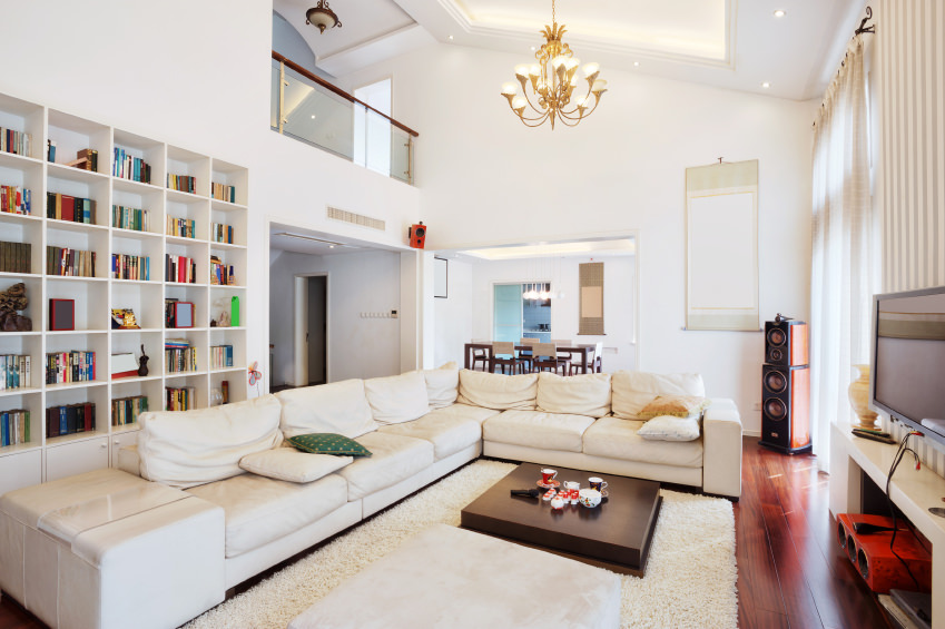 This White Library Living Room Is Stretched By A Long Off White Sofa Angled  On Part 33