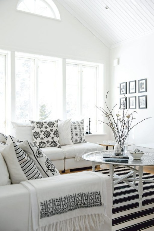 Black patterns on white creates a sleek and decorative look. This room just gleams with white and black shades.