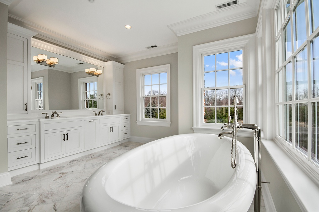 Bathroom with Traditional White-Framed Windows Wrapping Around Bathtub