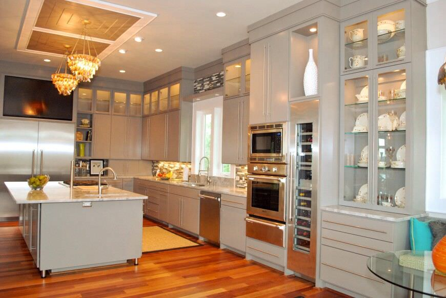Elegant Off White Kitchen Design With A Double Stainless Steel Oven Adjacent To A  Full Wine Part 29