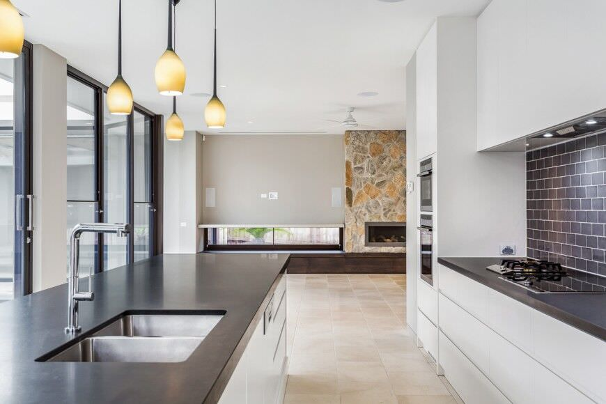 Minimalist White Kitchen Design With Double Wall Oven