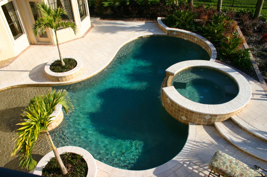 Overhead view of a kidney shaped pool with a lake-style gradual entry which ideal for kids.