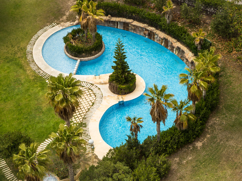 Here's a large kidney-shaped pool with an island.  I'm not too fond of the lack of patio but the island is kind of cool.