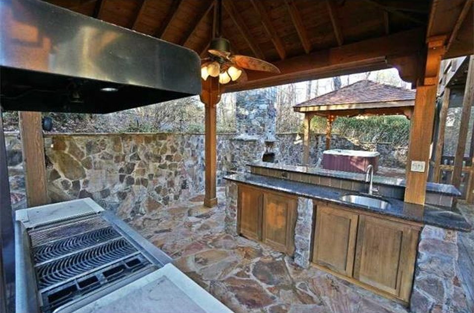Outdoor kitchen and patio in backyard of Atlanta starter home