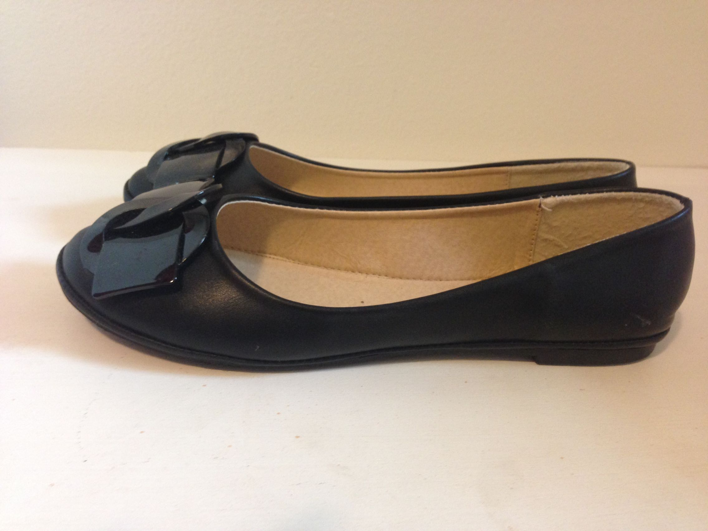 Black ballet flats with buckle detail