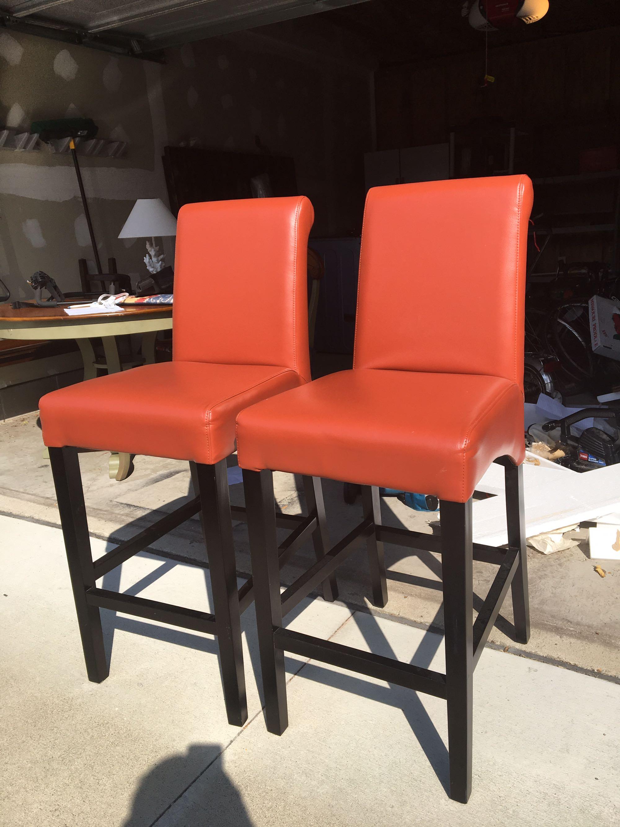 Orange leather barstool chairs (2)