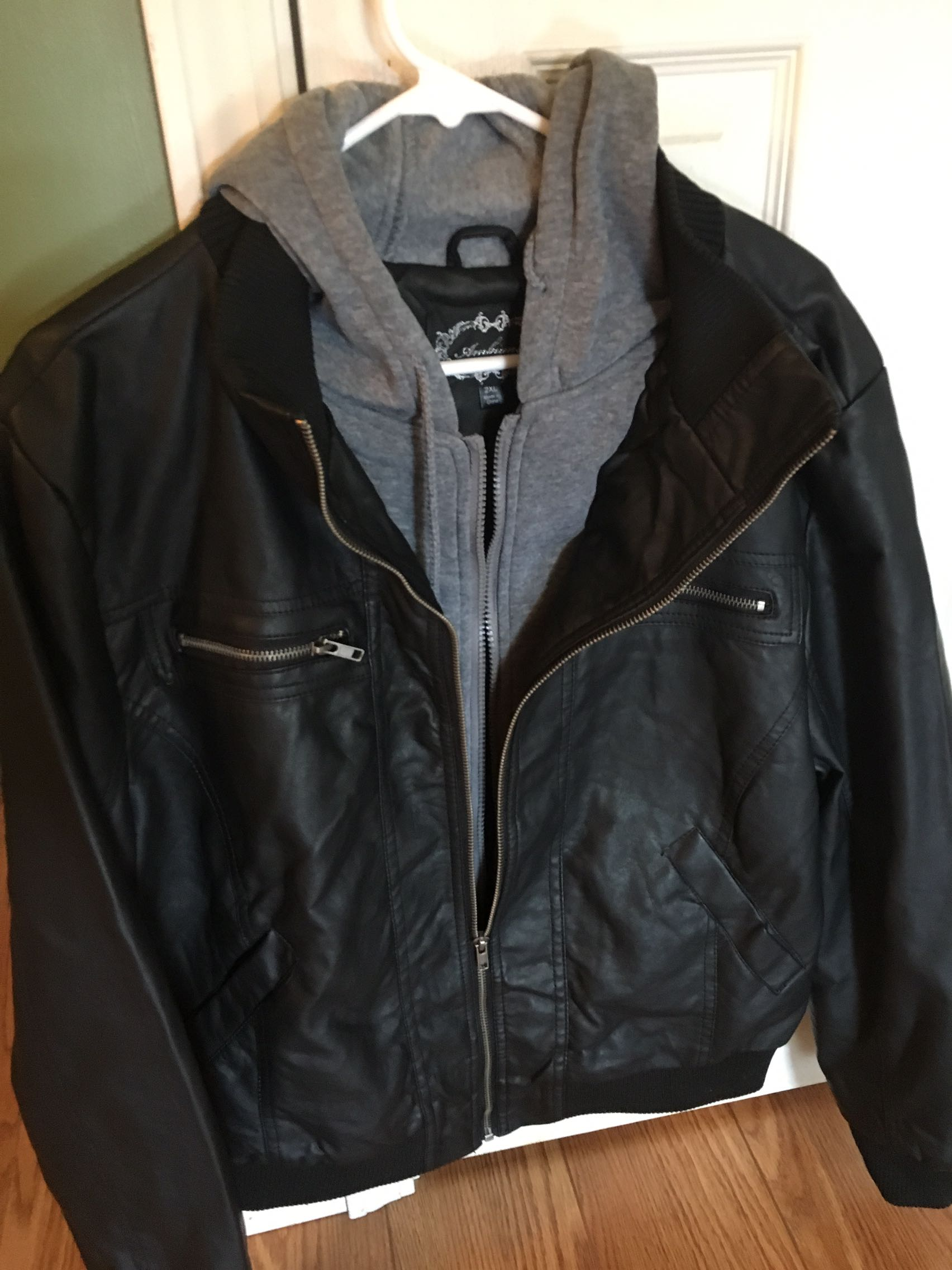 Never worn black faux leather coat!