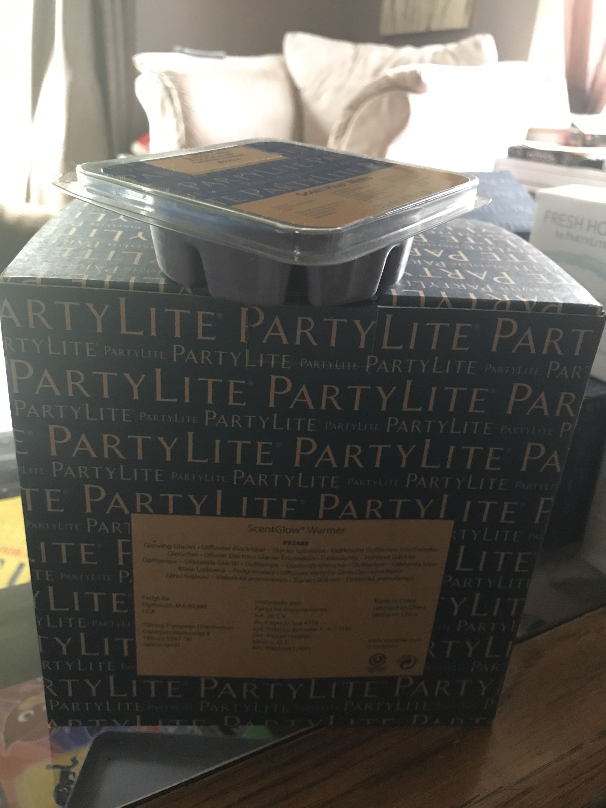 Brand new Partylite warmer with wax melts