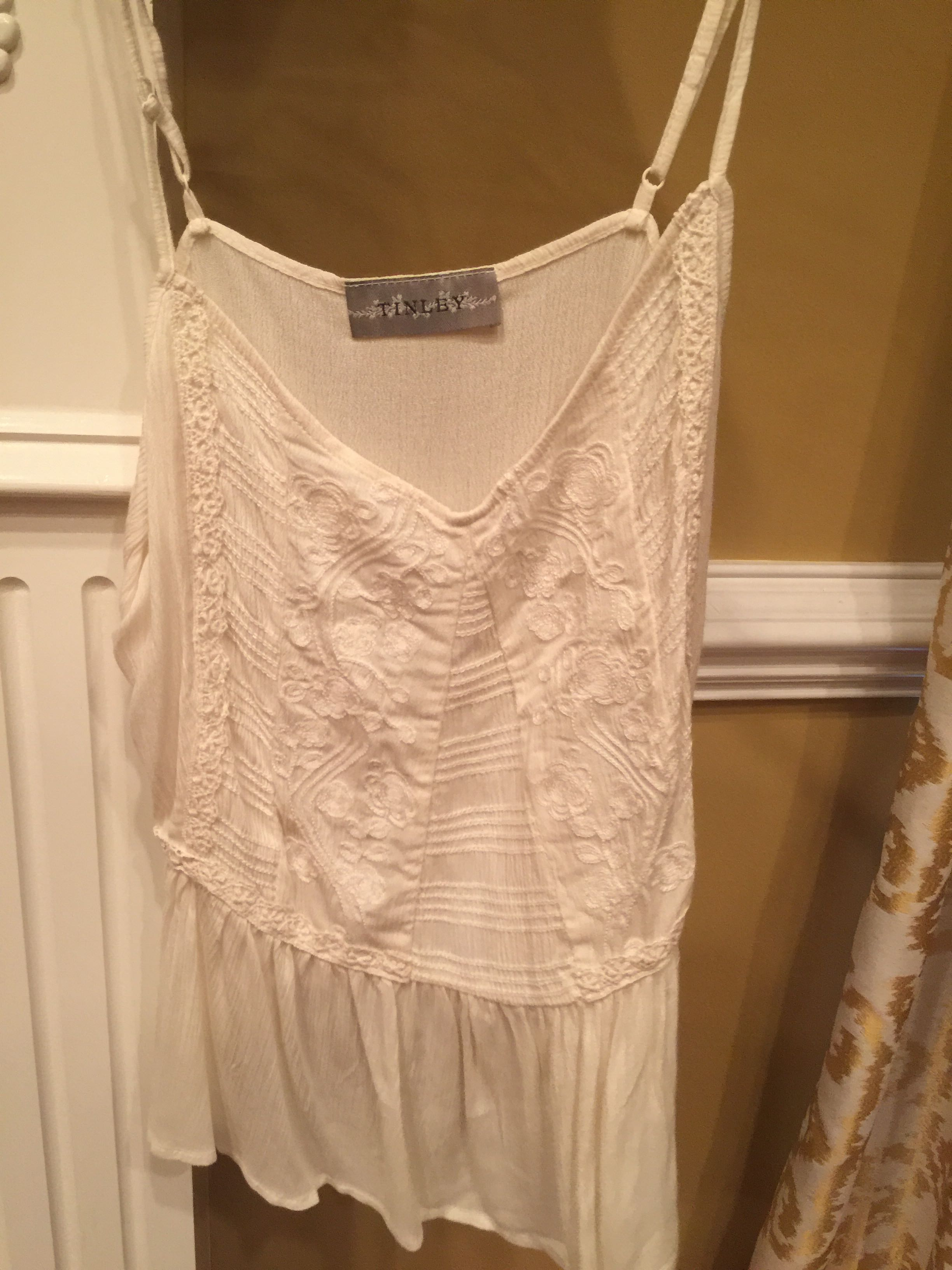 Beautiful cream colored cami from Entourage Boutique. Small.