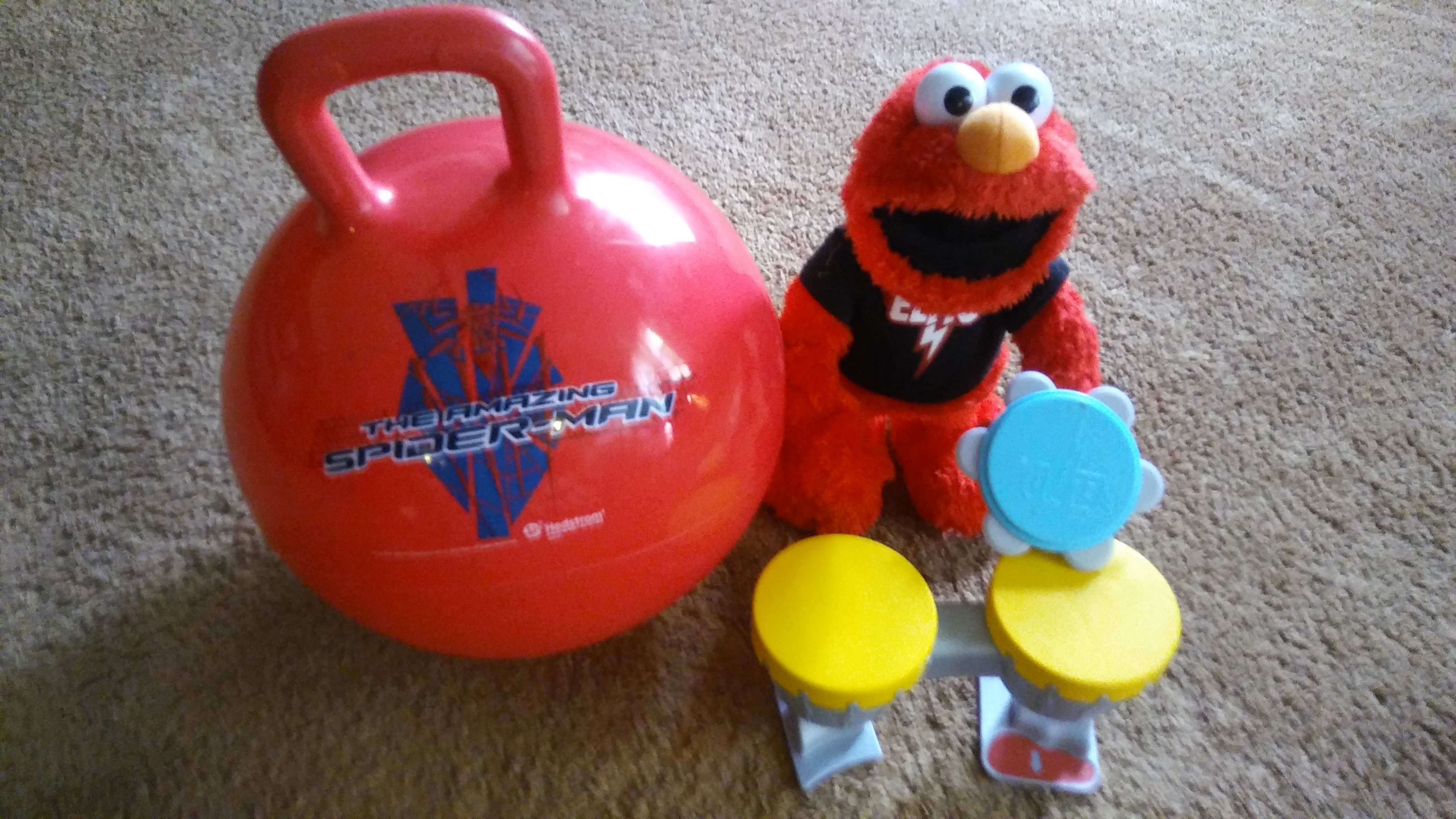Rock and roll elmo and spider man bounce ball lot $7 . Elmo works great. Plays drums and sings