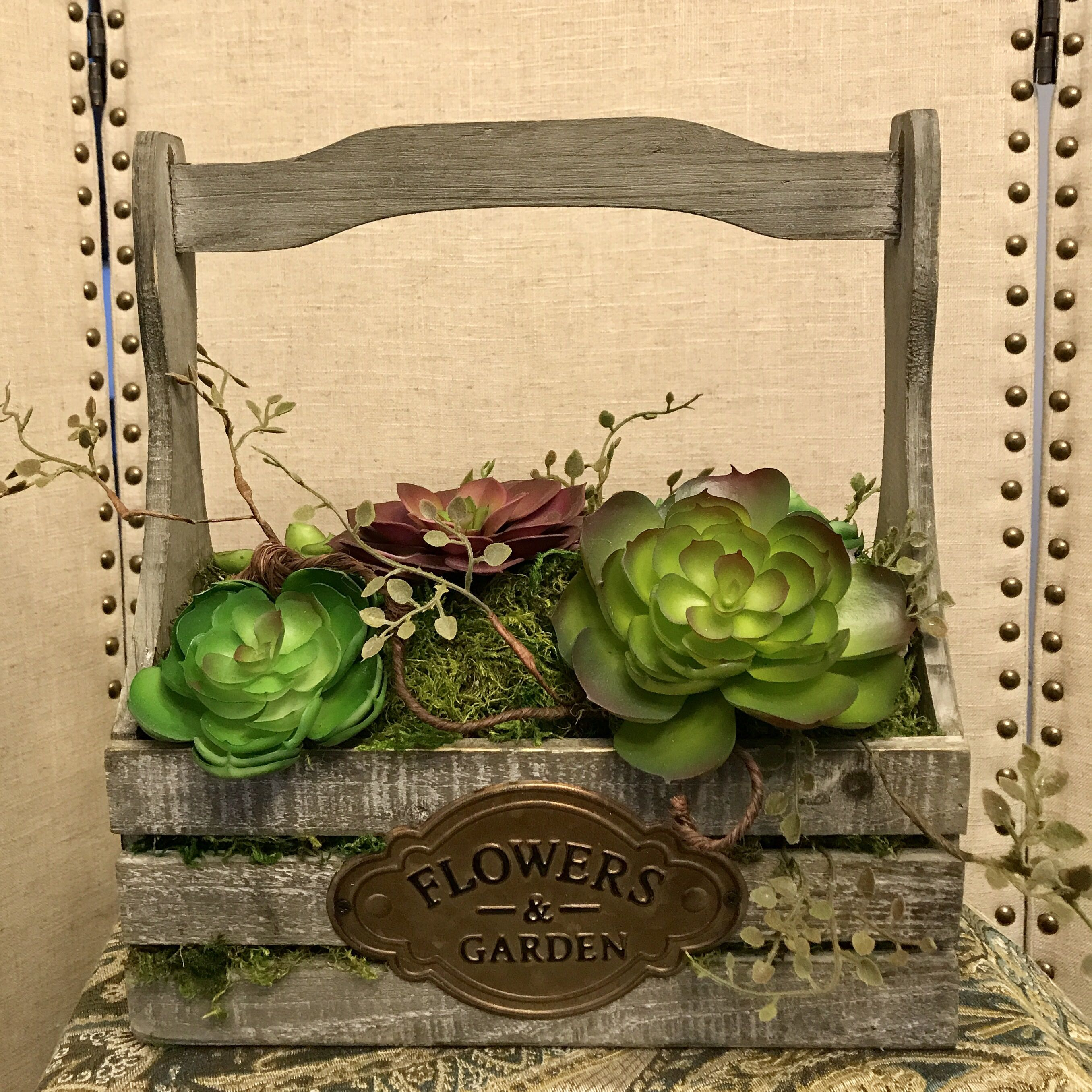 Large handled raw wood crate with lasting succulents