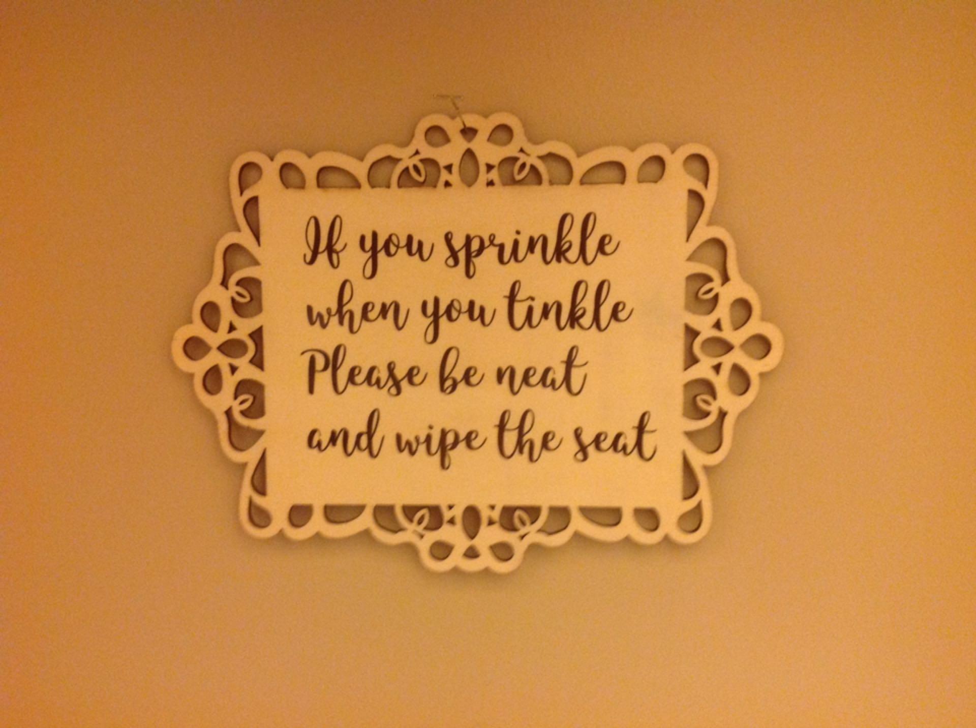 Decorative bathroom signs