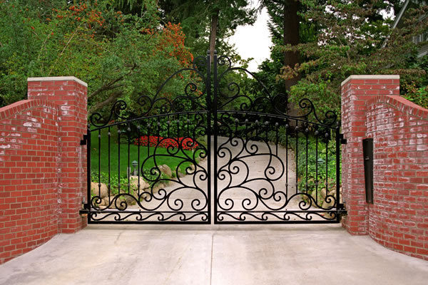 Wrought iron and brick commercial gates seattle wa for Brick and wrought iron fence