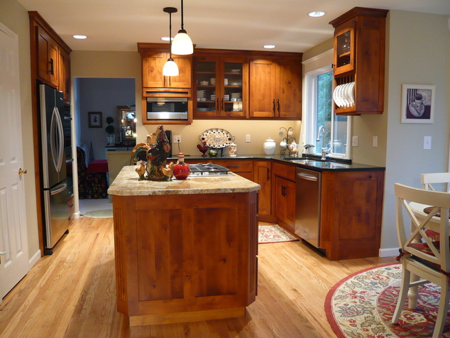 the owners chose contemporary pulls and cherry stained knotty birch cabinetry to create a warm blend of modern and traditional - Birch Kitchen Cabinet