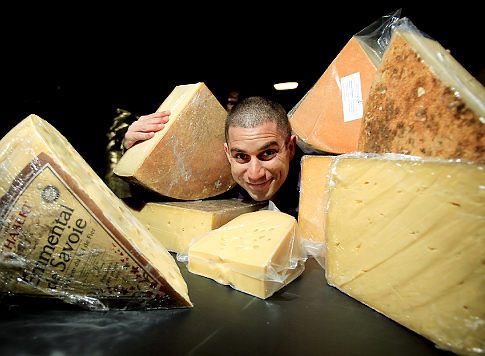 Adam Moskowitz, President of Larkin Inc., pose for photos with differnt kids of cheeses on Wednesday, June 23, 2010. Adam will be hosting Cheesemonger Invitational Competition inside his building located at 47-55 27th Avenue in Long Island City, Queens. Original Filename: _H4G9812.JPG
