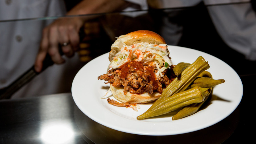 Lexington-style BBQ pork sandwich, served with slaw and pickled okra, one of the offerings of the Agricultural South section of the Sweet Home Cafe. The restaurant inside the National Museum of African American History and Culture has a menu designed to highlight the breadth of black contributions to the nation's cuisine.
