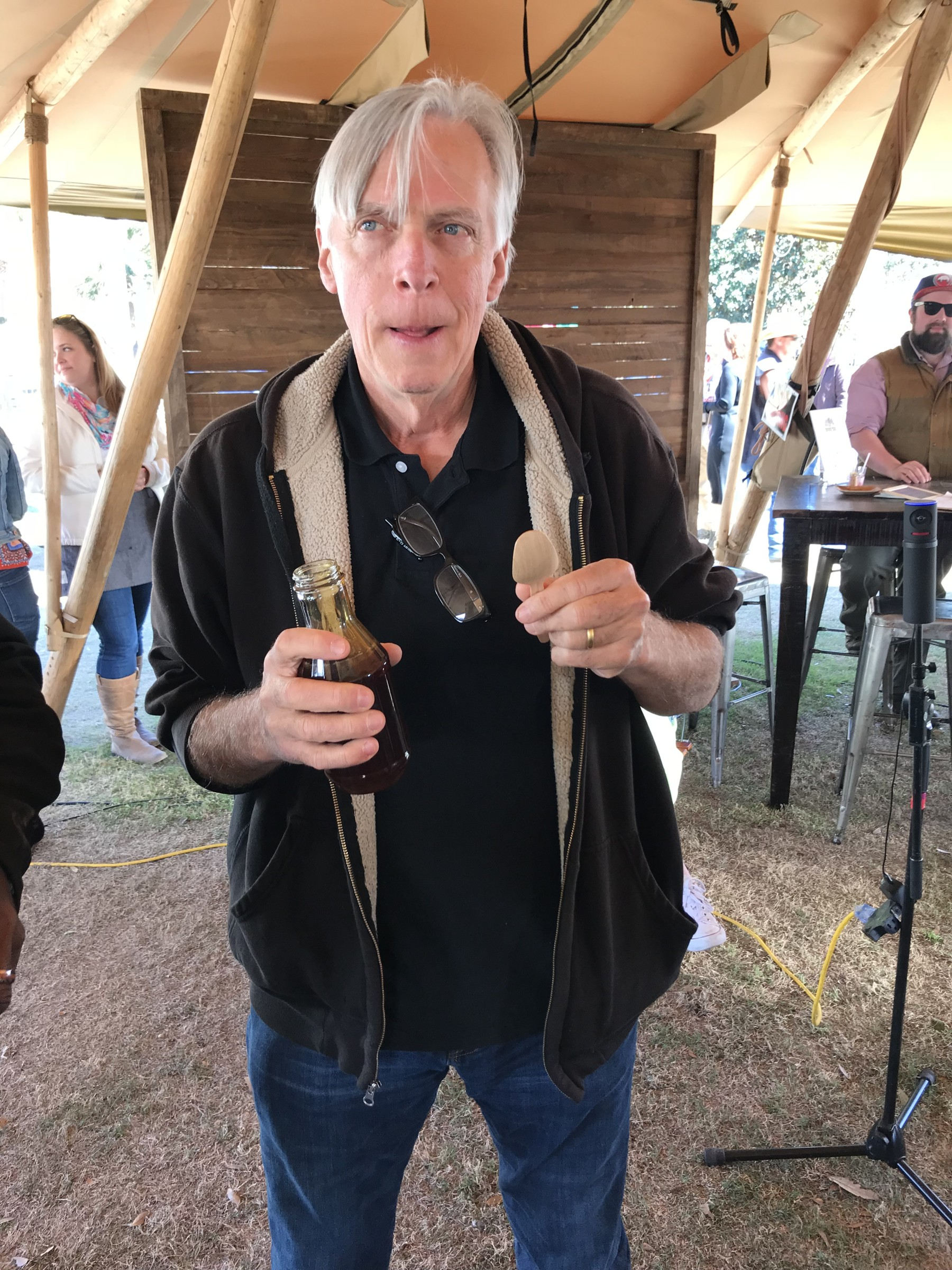 Glenn Roberts samples some cane syrup