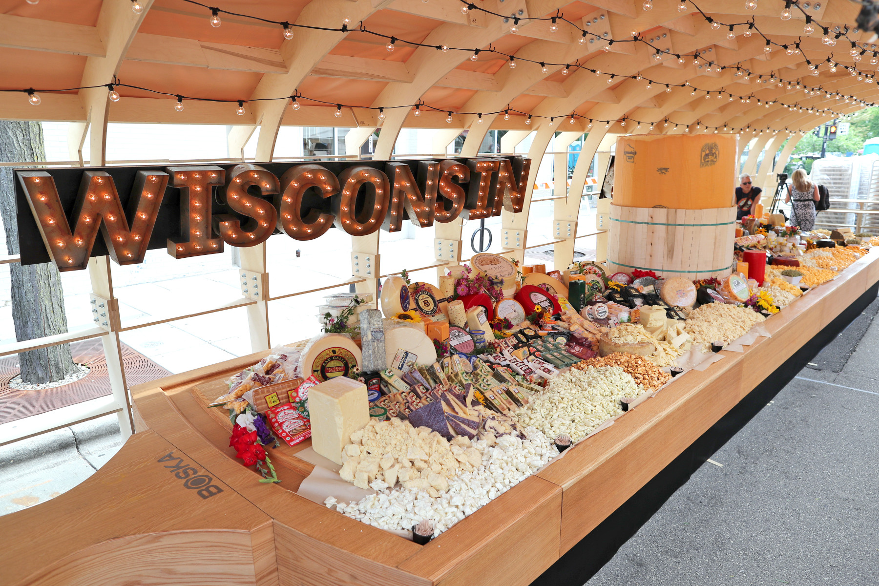 during a Guinness World Records winning attempt at the worlds largest cheeseboard in downtown Madison, Wis., on Wednesday, Aug. 1. The final weight of the cheese on the board came to 4,437 pounds.